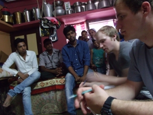 Priyank, Mike, and Jon interviewing people within Kalol.