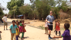Jon playing Frisbee with the kids in the village.